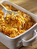Noodle gratin with pumpkin in a baking dish