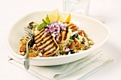 Grilled turkey strips on couscous salad
