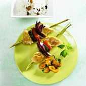 Chicken and vegetable kebab with Physalis compote and rice