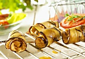 Aubergine rolls with pepper and soft cheese filling