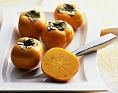 Five Sharon fruits (Diospyros kaki)