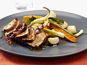 Pork fillet marinated in soy sauce, with vegetables