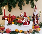 Christmas decoration: fruit, nuts, fir branches & Father Xmases