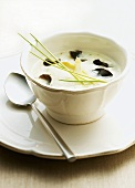 Asparagus and potato soup with black truffle