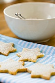 Star-shaped biscuits sprinkled with icing sugar