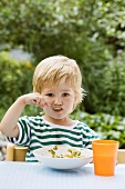 Boy with spoon in his mouth
