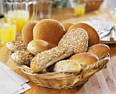 Assorted wholemeal rolls in bread basket