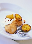 Salmon fillet with sour cream and fried lemons