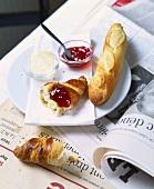 Breakfast of croissant, jam and baguette (France)