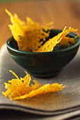 Mimolette cheese crisps in green bowl