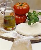 Pizza dough, fresh tomatoes, olive oil and fresh oregano