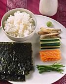 Ingredients for sushi: rice, nori, fish, cucumber and wasabi