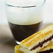 Espresso macchiato and cinnamon toast with chocolate cream