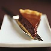 A piece of chocolate tart on server