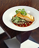 Salmon fillet on Asian noodles in soy sauce