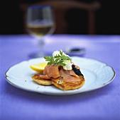 Blinis with salmon, caviar and crème fraiche