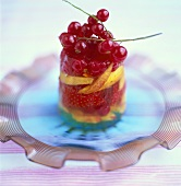 Jelly with berries and fruit on glass plate