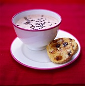 Cup of hot chocolate and raisin roll