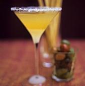 Martini and mango cocktail; grissini