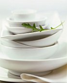 White crockery, decorated with rocket leaf