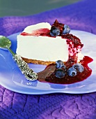 Piece of yoghurt cake with blueberry sauce