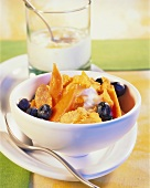 Cornflakes with papaya, blueberries and cultured milk