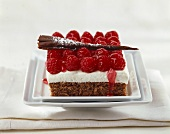 Chocolate and raspberry slice with chocolate curls