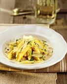 Potato noodles with mushroom sauce and cheese shavings