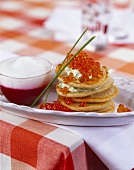 Blinis with caviar and beetroot sauce