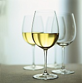 White wine glasses, half-full and empty