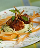 Lamb cutlets on sage mash with strips of carrot