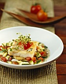 Cod fillet on courgettes and tomatoes
