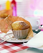 Muffin with icing sugar in paper case