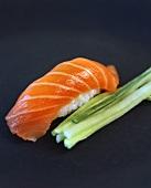 Nigiri-sushi with salmon; strips of cucumber