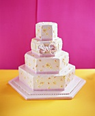 Four-tiered pink wedding cake