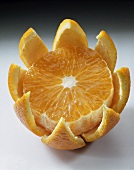 Orange (Citrus sinensis); half-peeled and with a piece cut off