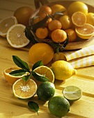 Citrus fruit still life on yellow wooden background