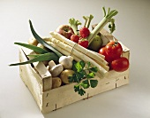 Wooden crate of vegetables, mushrooms and fruit