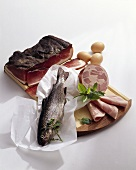Protein-rich foods: trout, sausage, ham, eggs