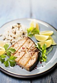 Tuna steak with rice, limes and coriander leaves