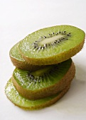 Slices of kiwi fruit in a pile