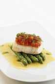 Halibut with tomato topping on asparagus & lemon sauce