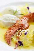 Lobster claw with fish mousse dumplings and frisée