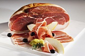 Parma ham with honeydew melon and olives