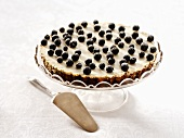 Blueberry tart on cake stand