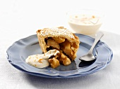 Small apple pie with cream and icing sugar