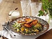 Fried salmon fillets on couscous