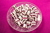 Cherry mint sweets on glass plate