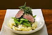 Fillet steak with mangetout and rosemary on mashed potato