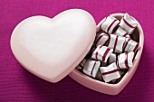 Cherry mint sweets in heart-shaped pink box